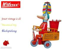Mechanical toy fireman duck retro