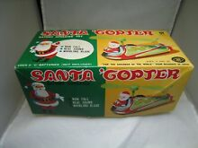 Masudaya japan santa copter tin toy