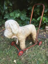 Toy dog on wheels smaller than