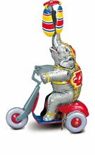 Mechanical toy elephant on scooter