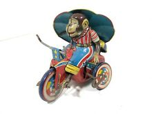 Lucky monkey cycle toy wind up tin