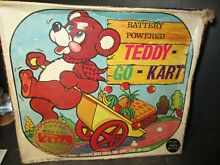 Teddy go kart fur covered tin bear