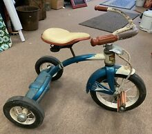 Blue tricycle from 1950 s 1960 s