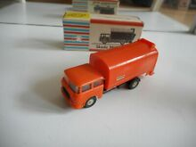 Veb skoda garbage truck in orange