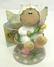Guardian angel cheeks figurine