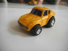Toy pocket dash datsun in yellow