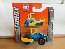 Road roller in yellow blue on