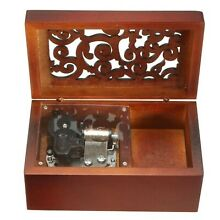 Engraved wooden wind up musical box