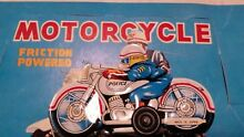 Police motorcycle tin toy penny toy