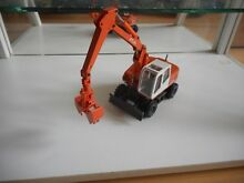 Conrad excavator 1304 in orange on