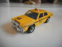 Ford ltd taxi in yellow