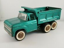 Turquoise hydraulic dump truck toy