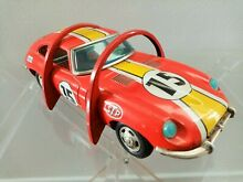 Jaguar e tin toy stunt car form the