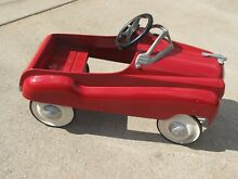 Champion red pedal car 1950 s