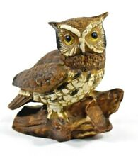 Decorative great horned owl on log