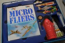 Tin of new micro fliers kit book