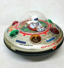 X 7 space ship tin toy never used