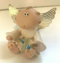 Angel cheeks by small dragonfly