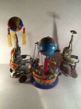 Elephants and ferris wheel tin toys