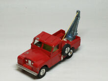Land rover 109 w b tow truck red
