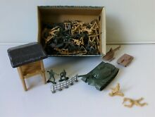 Box of plastic toy soldiers