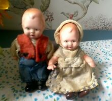 Pair of dressed dutch dolls jointed