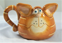 Orange tabby cat face mug