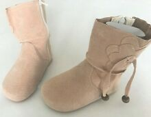 Unique leather light pink boots for