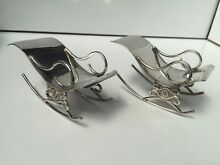 Real silver rocking chairs dolls