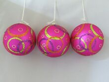 Three christmas baubles hanging