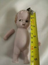 Bisque doll jointed arms