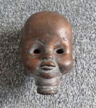 Rare large copper baby doll head