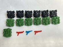 Mattel back packs and weapons lot