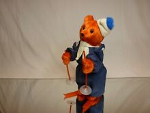 Hairy wind up bear on skis h24 0cm