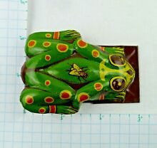 Litho green frog tin clicker fly on