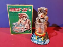 Battery operated hungry cat tin toy