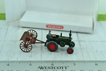 8890231 agricultural tractor w rake