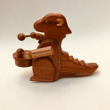 Traditional wooden toy dinosaur