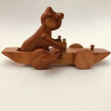 Traditional wooden toy cat in a