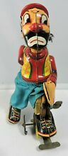 Japan tin toy litho wind up roller