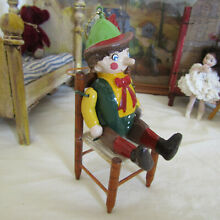 Jointed wooden pinnochio puppet
