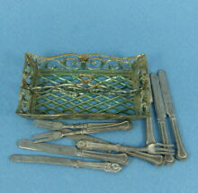 Dolls house cutlery in basket