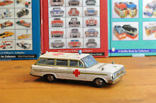 Tin toy asc ambulance station car