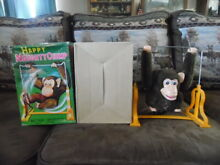 Happy naughty chimp in the box made