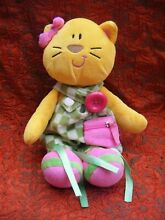 Yellow cat in green dress 11 approx