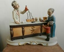 Apothecary shop figurine signed