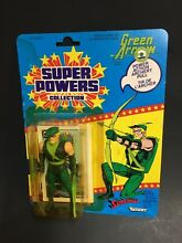 Green arrow figure on cardback read