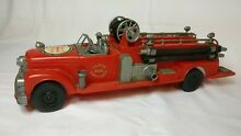 Red plastic fire engine seagraves