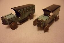 A pair of tinplate penny toy buses