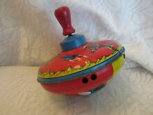 Tin toy spinning top astronauts and
